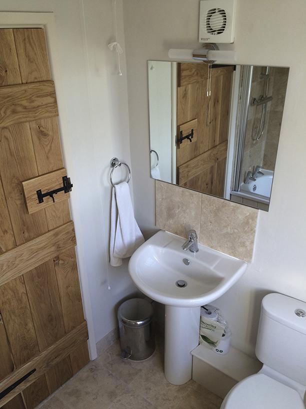 Oak door and travertine floor